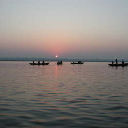Solemn sunrise on the Ganges River in Varanasi, India, 2009, by Waheed Rabbani