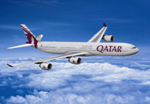 photograph of Qatar Airways jet in flight