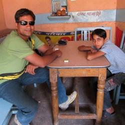 Photograph of Satish in chai shop, old city market, Sawai Madhopur