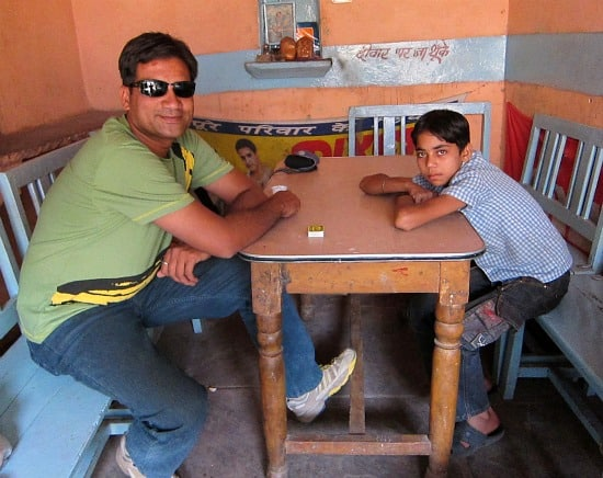 Photograph of Satish in chai shop, old city market, Sawai Madhopur