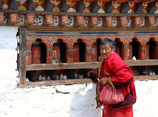 Photograph of woman and prayer wheels, Paro, Bhutan