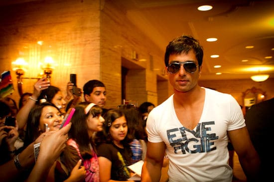 Bollywood actor Sonu Sood and fans in the lobby of the Fairmont Royal York Hotel during the IIFA Awards. Photo courtesy Andrew Adams of Katha Images.