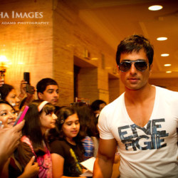 Bollywood actor Sonu Sood and fans in the lobby of the Fairmont Rpyal York Hotel during the IIFA Awards