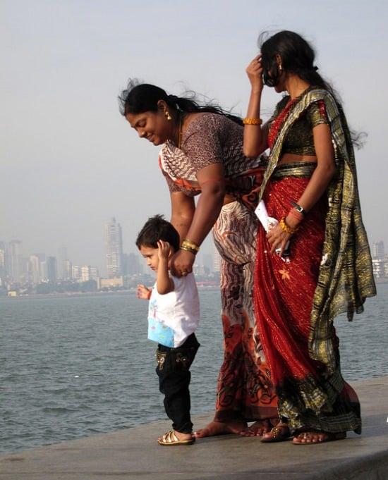 Photograph of a family on the Marine Drive seawall, Mumbai, India