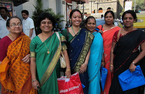 Photograph of the women of India, in saris, shopping in Bangalore