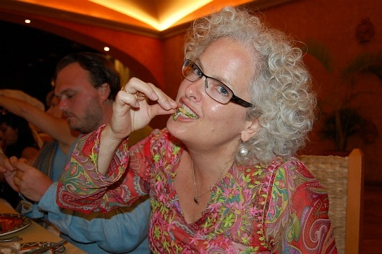 Photograph of solo traveler Janice Waugh eating crickets in Mexico