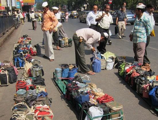 Photograph of tiffin-wallahs, Churchgate station, Mumbai, India