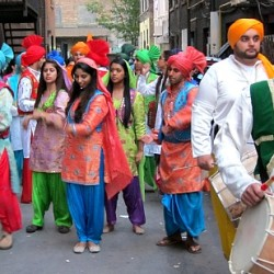 Bhangra musicians and dancers getting ready for the Breakaway premier parade