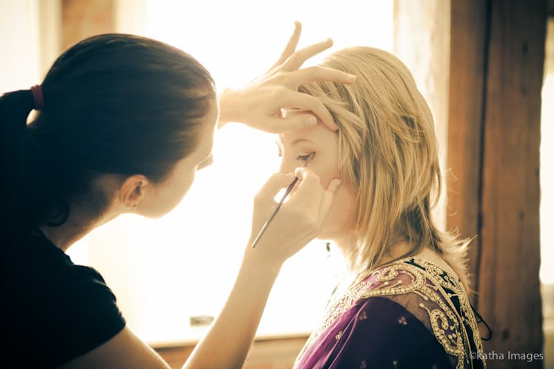 Photograph of Olga Kirnos applying makeup by Andrew Adams of Katha Images