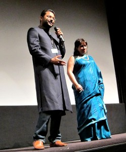 Photograph of Rubhir Dasgupta and Guneet Monga on stage at TIFF for Michael