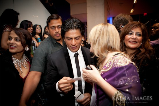 Caught in the act! Me handing Shahrukh Khan my card and reminding him we have met before. Photo by Andrew Adams of Katha Images.