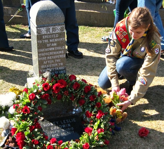 Placing flowers on the grave of the Unknown Child, Halifax, April 15, 2012