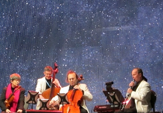 Rhapsody Quintet playing Nearer My God To Thee with starry sky behind and flares being shot overhead, Night of the Bells, Halifax, April 15, 1912, 12:27 am