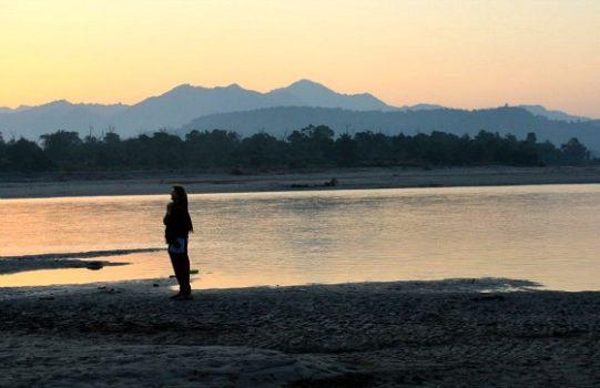 Me, watching the sunrise on banks of Ganga near Aurovalley Ashram, India