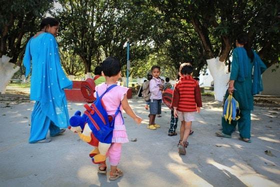 Teachers and children arriving at Aurovalley Ashram, India