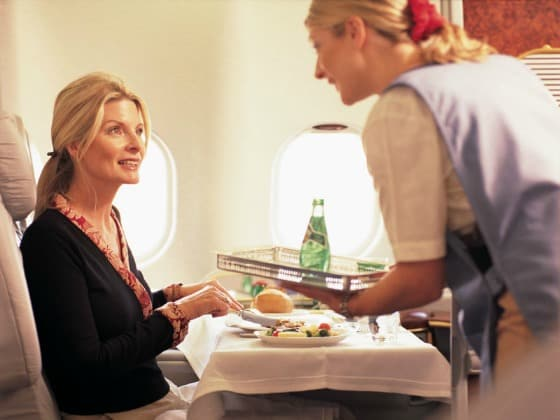 Passenger enjoying business class service on Emirates.