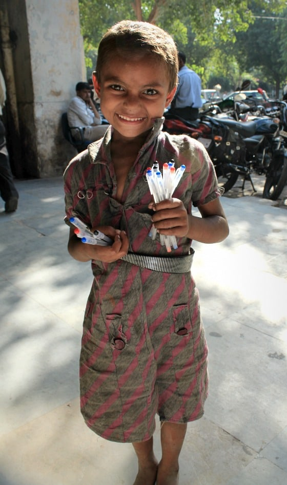 Street Girl in Janpath, Delhi, India selling pens
