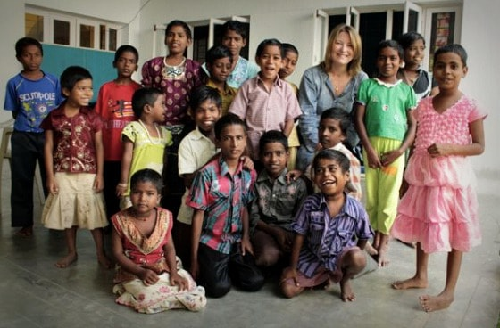 Mariellen Ward surrounded by the children at TDH CORE in Tiruvannamalai, Tamil Nadu, India