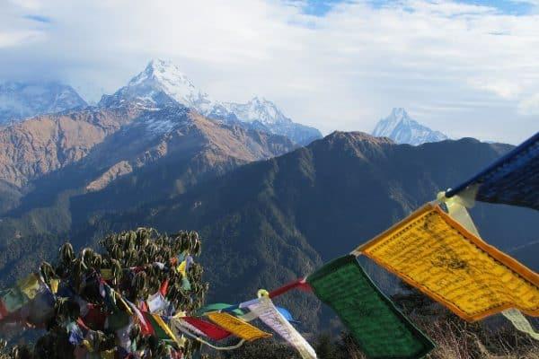 prayer flags and Himalaya mountains