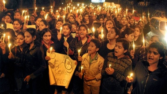 Students in India hold placards during a protest against the Delhi gang rape case. Photo: PTI