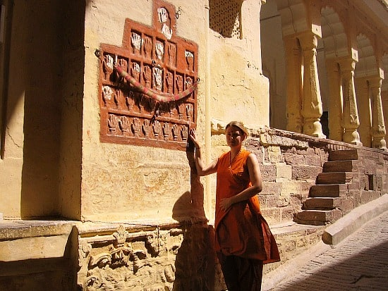 Me, touching sati prints at Jodhpur Fort, India