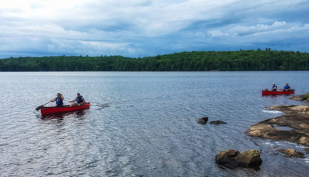 canoes on a summer lake in Ontario
