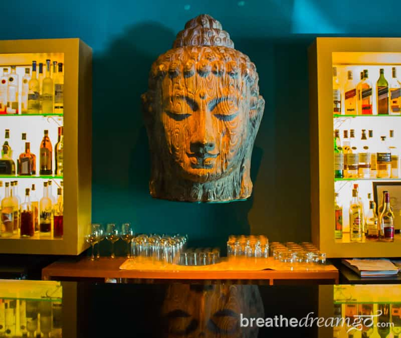 Bar with Buddha head and bottles in Goa