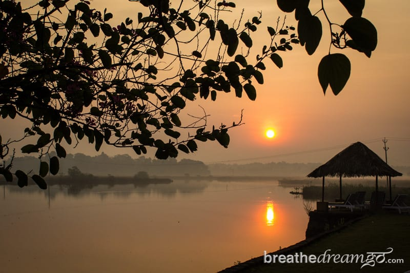 Sunrise on a river in Goa, India