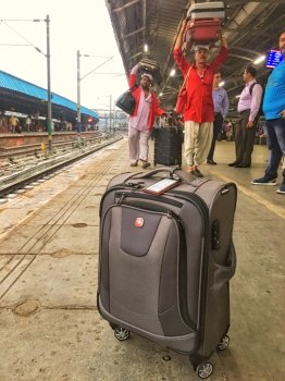Luggage and porters on Indian railway platform