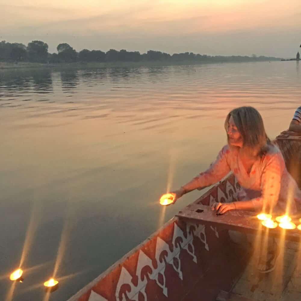Releasing light-filled diyas into the Narmada River in Maheshwar, Madhya Pradesh, India