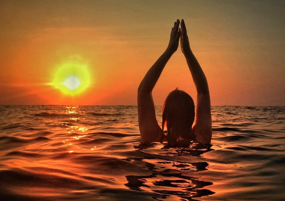 Mariellen Yoga pose in the ocean