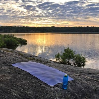 Responsible travel products: water bottle and yoga mat
