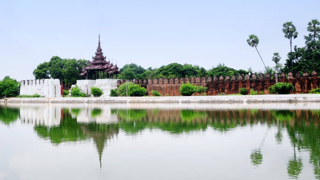 Myanmar travel photo: Mandalay temple and reflection in water