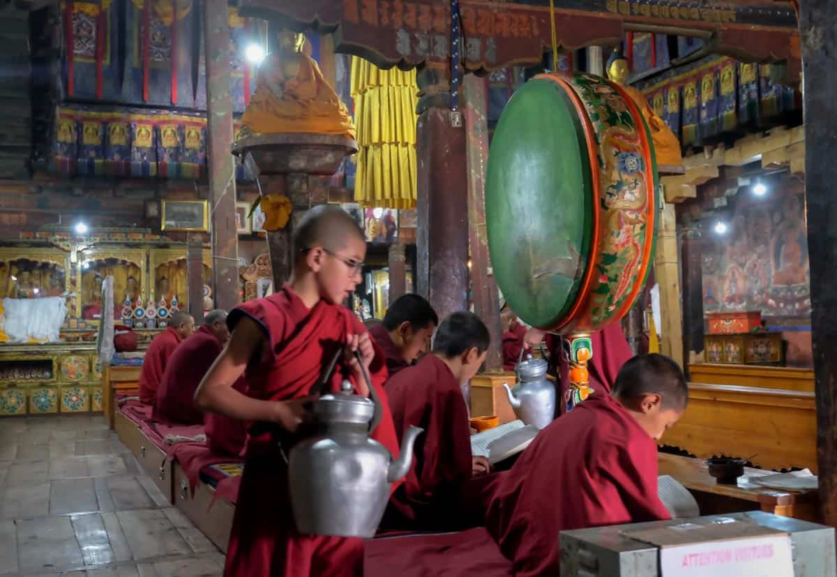 Buddhist monks in temple in Ladakh