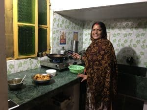 Woman cooking at homestay in Pushkar, Rajasthan