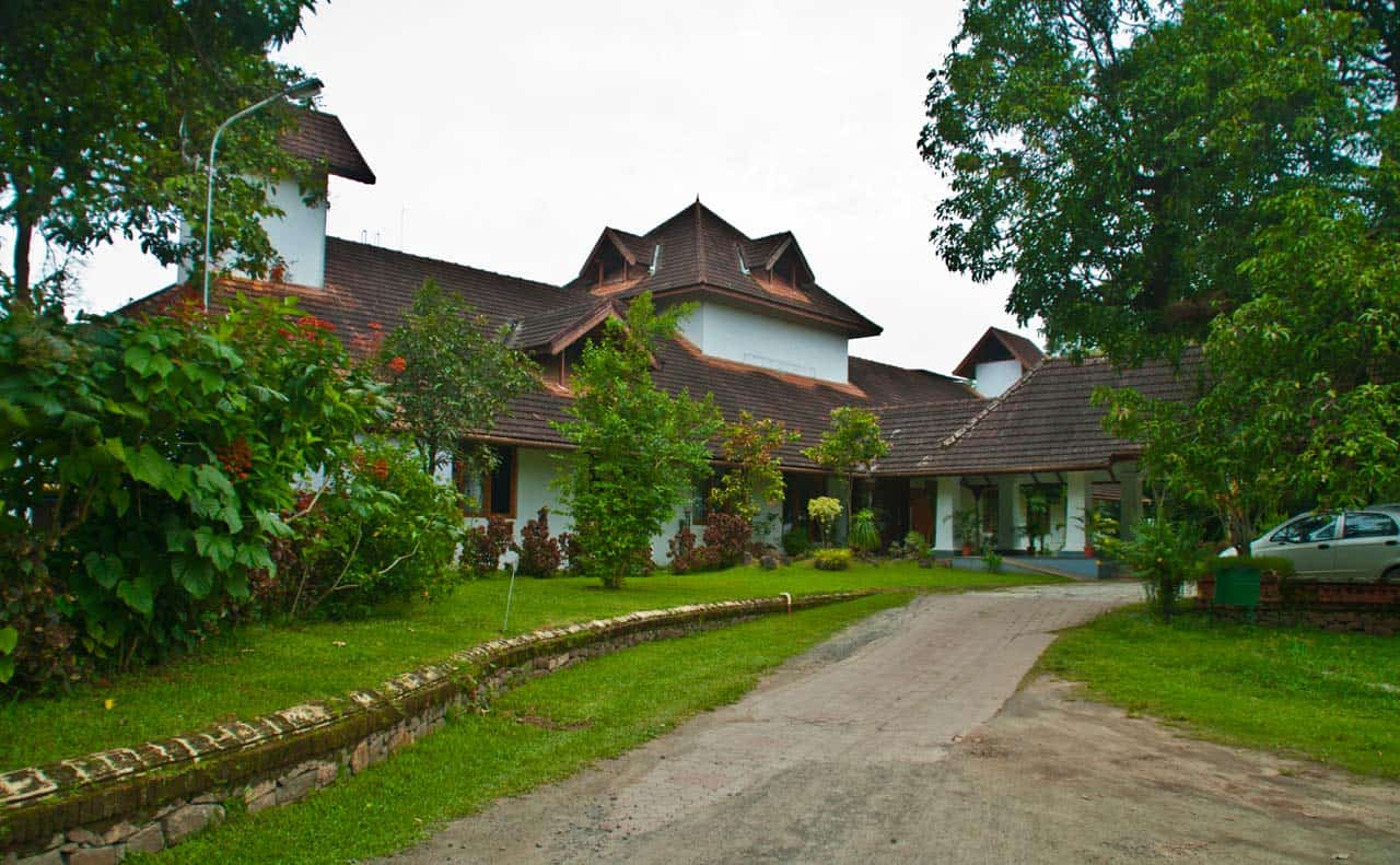 driveway, lawn, and red-tiled building in Kochi, India