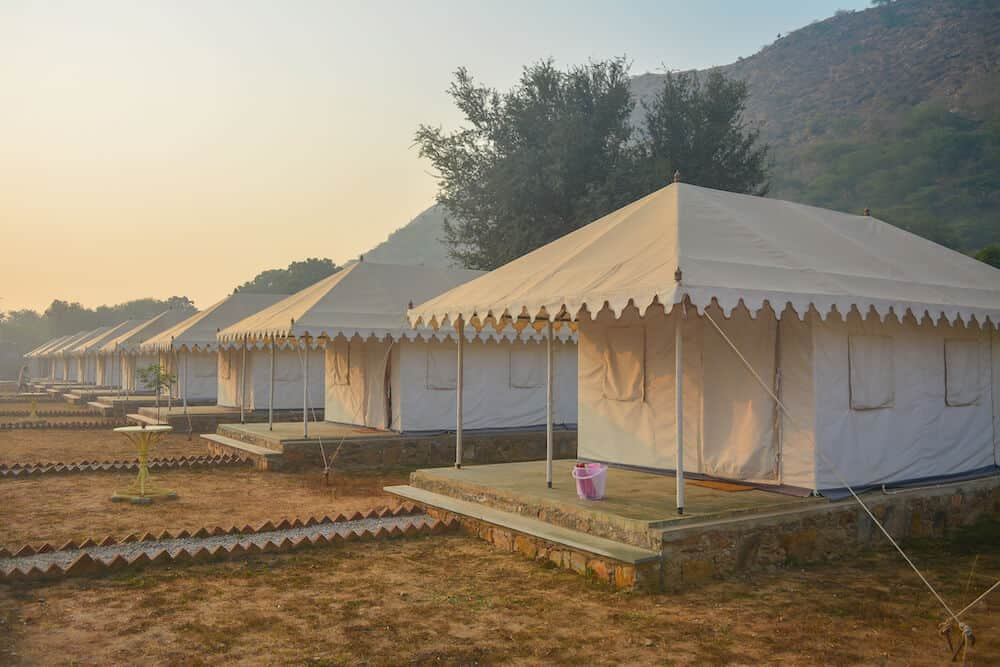 white luxury tents in the desert of Rajasthan