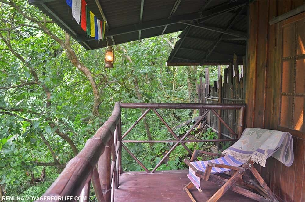 view of wooden balcony and forest in Goa