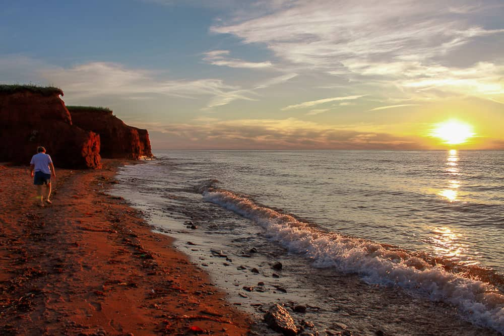 Prince Edward Island famous red sand beach at sunset