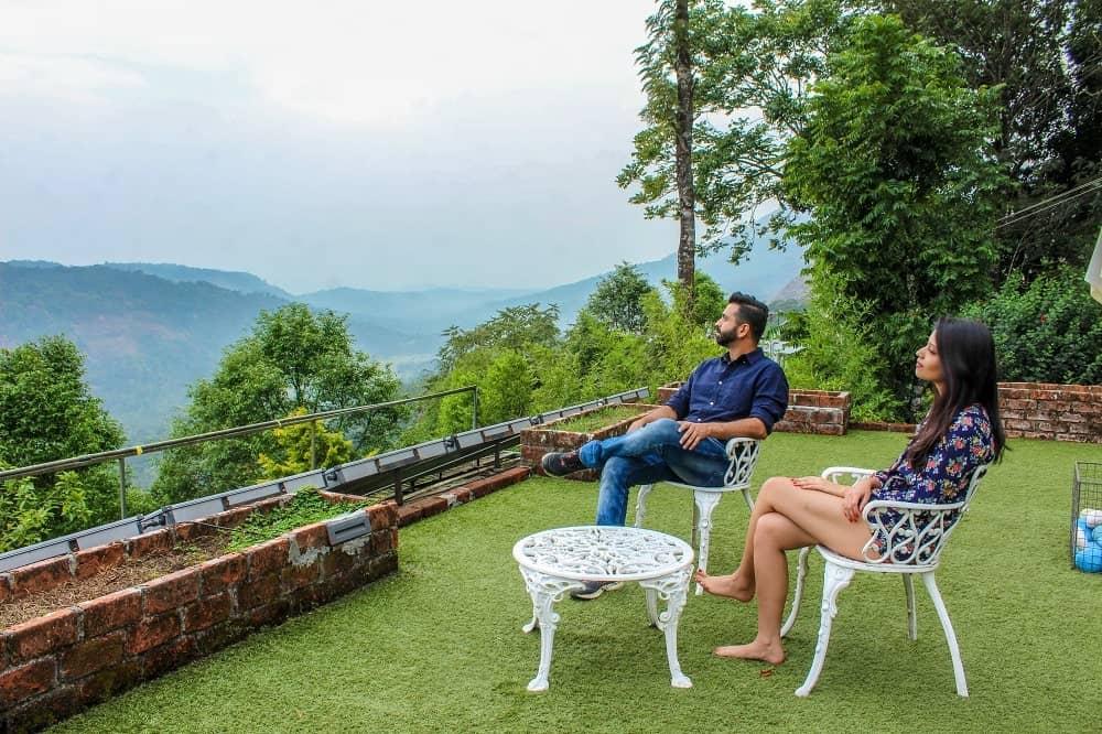 couple looking at hills of Munnar, Kerala