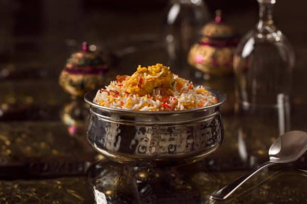 silver bowl with biryani