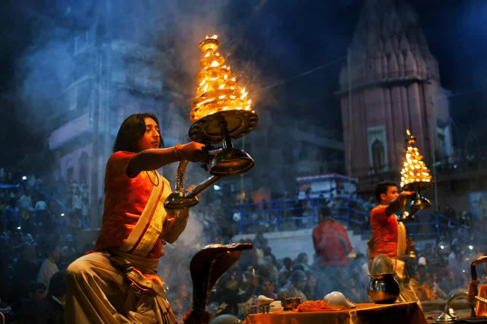 prayer ritual of Ganga Aarti in Varanasi with lights and fire