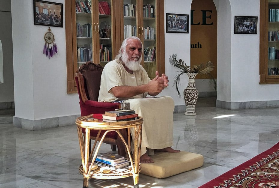 Swami Brahmdev in the library at Aurovalley Ashram