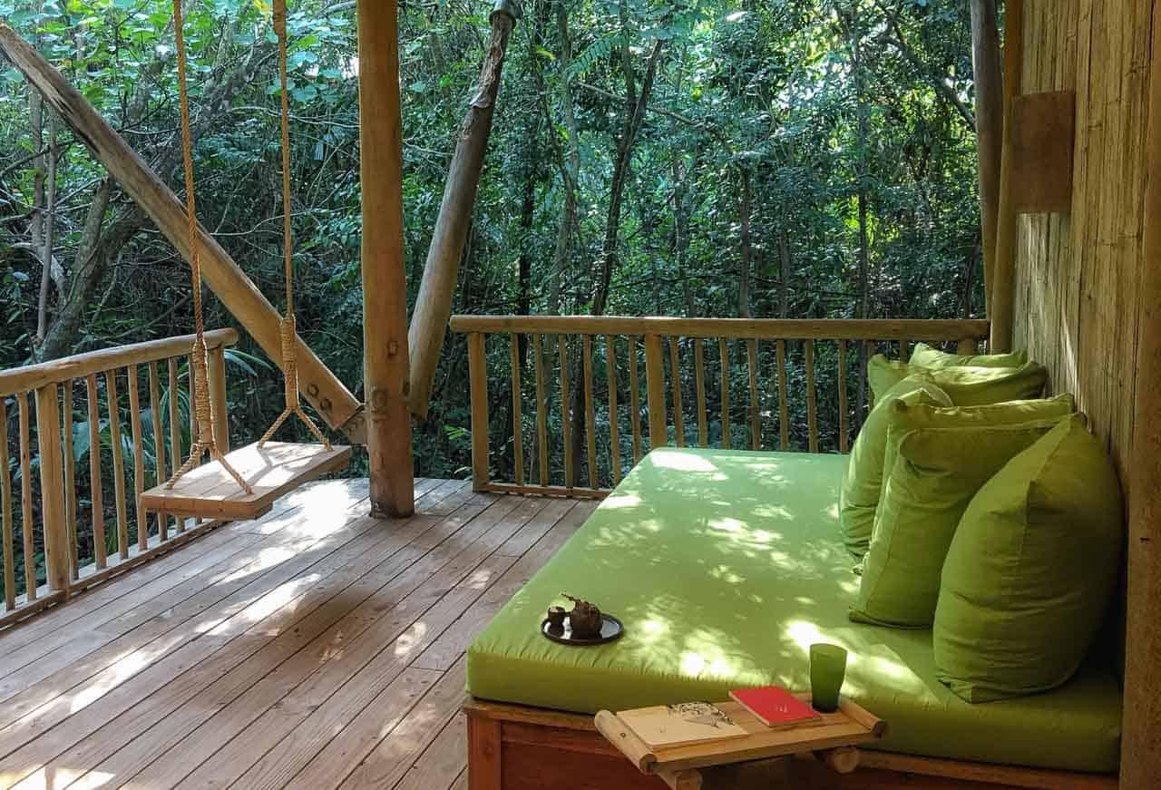 sofa and chair swing at Soneva Kiri, Thailand resort