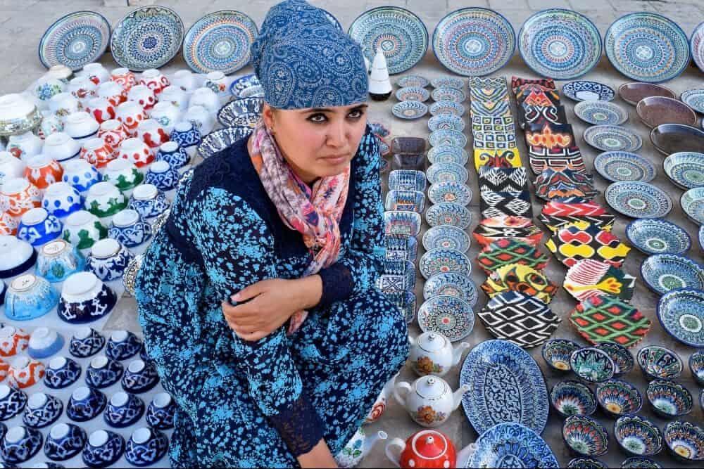 Woman selling ceramics in Uzbekistan