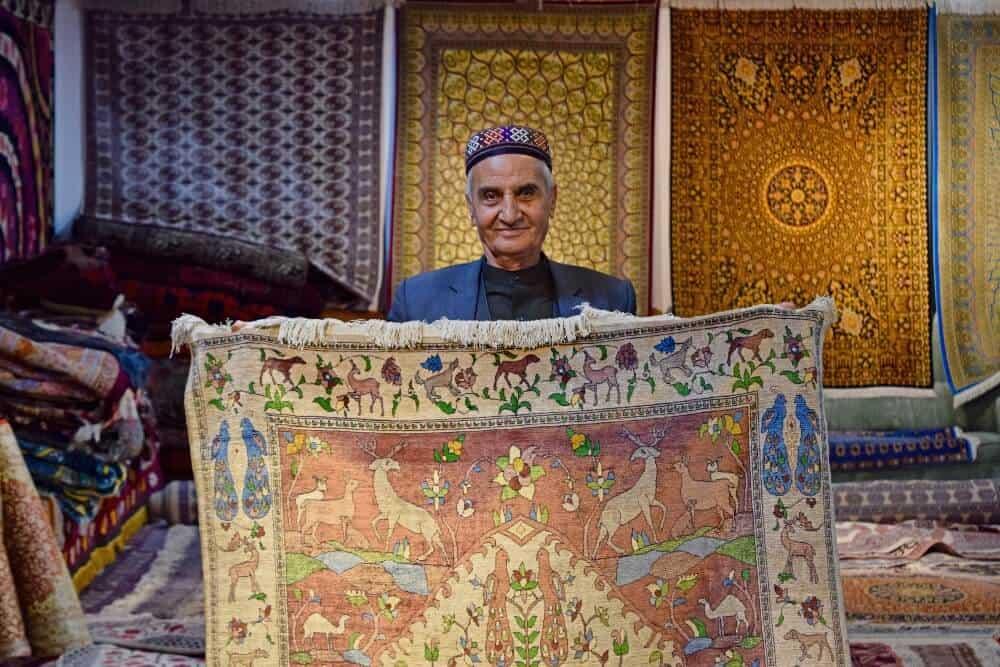 man selling carpets in Uzbekistan