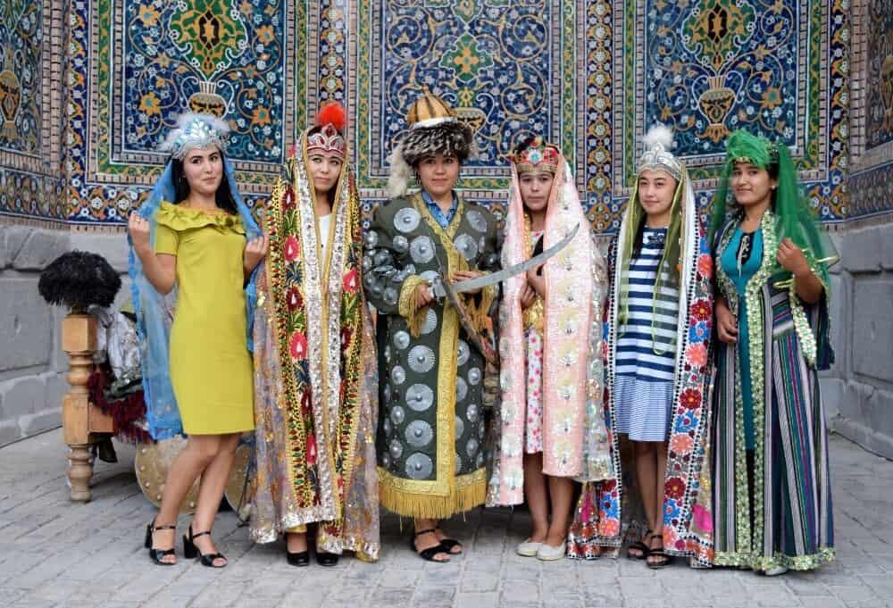 Girls posing in traditional dress at The Registan, Samarkand, Uzbekistan