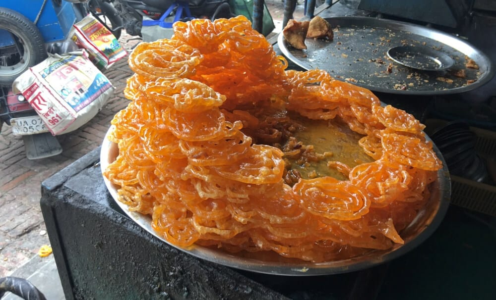 a pile of jalebis at a street stall in India